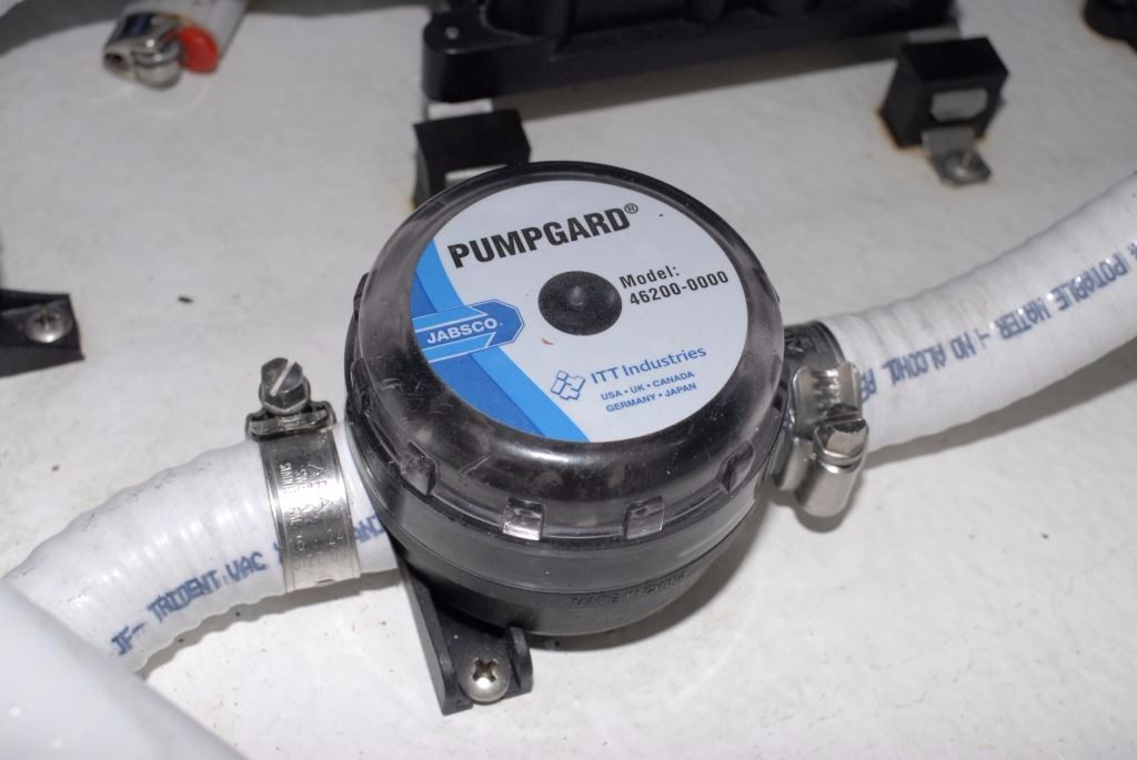 Bilge pump systems design and installation steve dantonio marine for bilge drying a self priming diaphragm type pump top and middle is often the best choice located well above bilge water its pick up hose can remove ccuart Choice Image